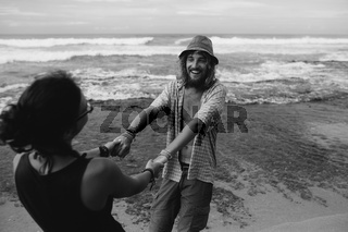 guy and girl have fun on the beach