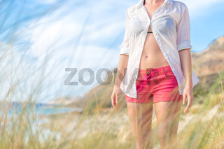 Relaxed woman in white shirt enjoying in nature.