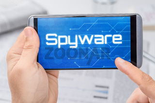 Smartphone with the text Spyware on the display