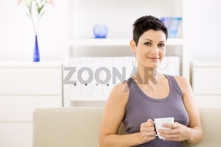 Woman drinking coffee at home