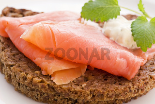 Smoked salmon on wholemeal bread as closeup on a plate