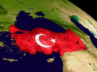 Turkey with flag on Earth