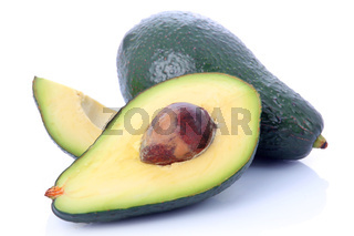Ripe sliced avocado fruits isolated on white
