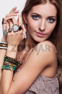 Beautiful woman in jewelry and  bijouterie