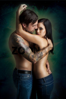 romantic intimate young couple standing on colorfull background