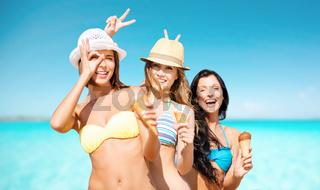 happy women eating ice cream over sea and sky
