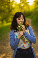 woman holding bouquet and smell flower aroma