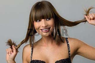 Cheeky girl with hair braid. Maedchen mit Zoepfen