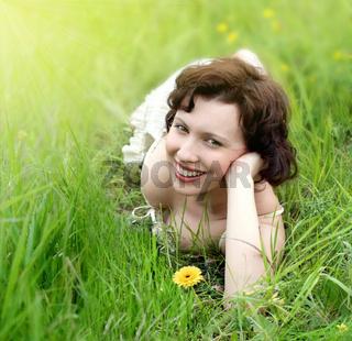 beautiful young woman relaxing in the grass