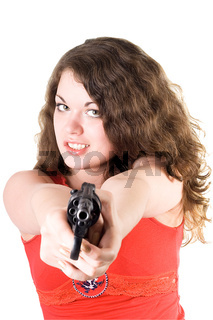 Young woman with a revolver. Isolated on white background
