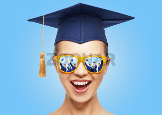 happy teenage girl in shades and mortarboard hat