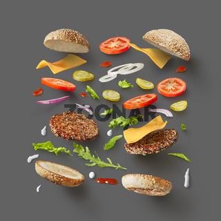 Burger ingredients against dark grey background