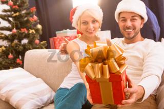Happy Christmas couple celebrating New Year