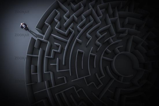 a business man at the maze