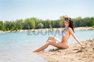 Summer beach stunning woman sunbathing in bikini