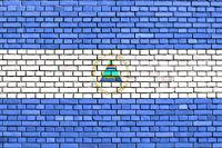 flag of Nicaragua painted on brick wall