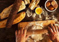 Baker making fresh organic bread for breakfast