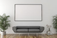 Blank picture frame in empty room with sofa