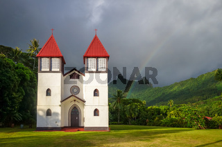 Rainbow on Haapiti church in Moorea island, landscape