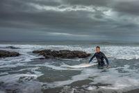 Surfer Returning from Ocean