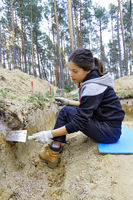 The girl-archaeologist working on the excavation