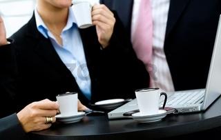 Closeup of hands during coffee break