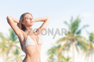 Young woman on tropical beach