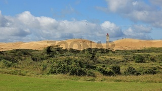 90 meter high sand dune and lighthouse at the west coast of Denmark. Rubjerg Knude.