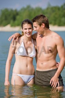 Couple in swimwear enjoy water and sun