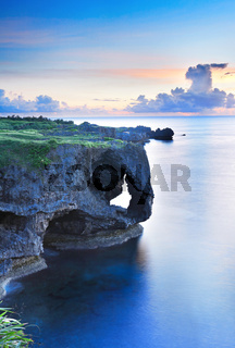 sunset on the rocks , in Okinawa , Manzamo