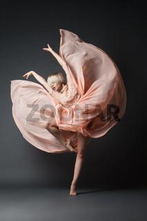 Woman dancing in chiffon dress