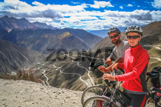 Cyclists on top of the mountain pass in Yunnan