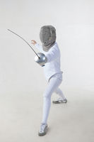 Female fencer isolated on white background