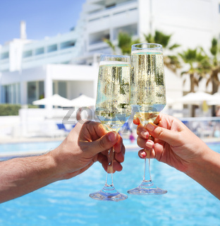 Two champagne glasses in man and woman hands