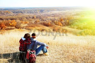 Man and woman are hiking