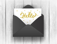 Black opened envelope with Hello Lettering on wooden background.