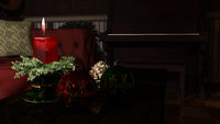 Christmas candle and ornaments over indoor dark background