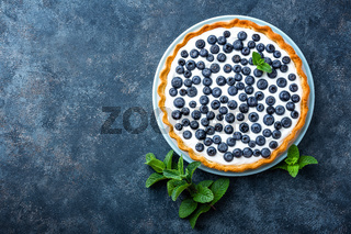 Delicious dessert blueberry tart with fresh berries and whipped cream, sweet tasty cheesecake, berry pie. French cuisine