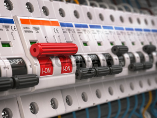 Switches in fusebox. Many black circuit brakers in a row in position OFF and one red switch in position ON.