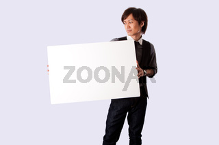 Young business man with white board
