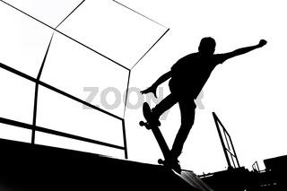 Black and white skater silhouette illustration on the ramp