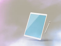 Mockup of a tablet computer on white background with stylus
