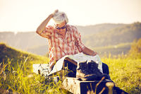 Hiker sitting in the sun with map