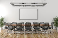 Conference room with blank picture frame in background