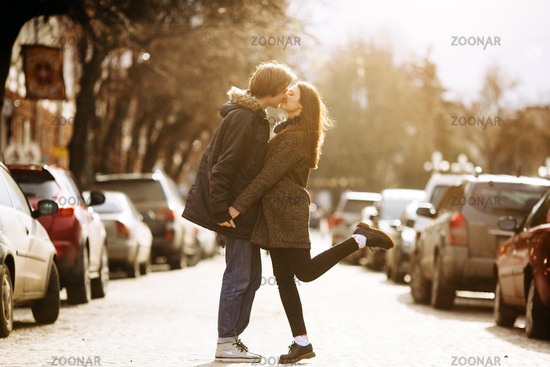 guy and the girl kissing on city street