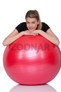 Fitness - Young woman with exercise ball on white