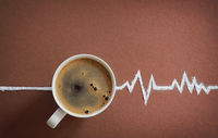 Coffee cup top view and heart beats cardiogram
