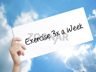 Exercise 3x a Week Sign on white paper. Man Hand Holding Paper with text. Isolated on sky background