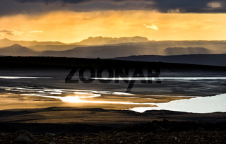 Colorful sunset over mountains, river and lake. Fantastic view. Iceland.