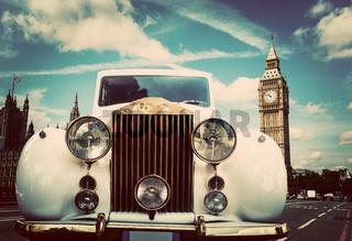 Retro car, limousine next to Big Ben, London, the UK